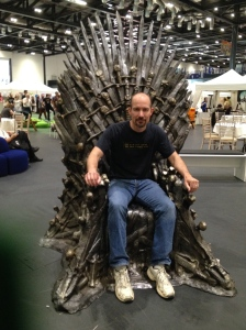 The Chemist tries out the Iron Throne.
